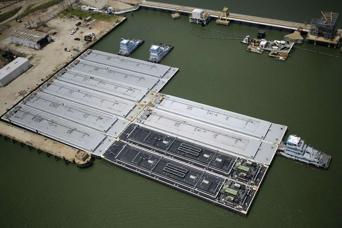 Petroleum barges docked in port are seen in this aerial photograph taken above Texas City, Texas, U.S., on Wednesday, Aug. 30, 2017.