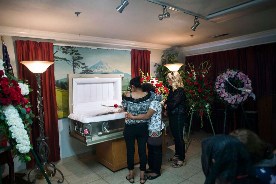 A memorial service is held for Veronica Cabrera Ramirez on Tuesday in Windsor. She was allegedly killed by her boyfriend, Nery Israel Estrada Margos, who had been released instead of being handed over to ICE. Photo: Brian L. Frank, Special To The Chronicle