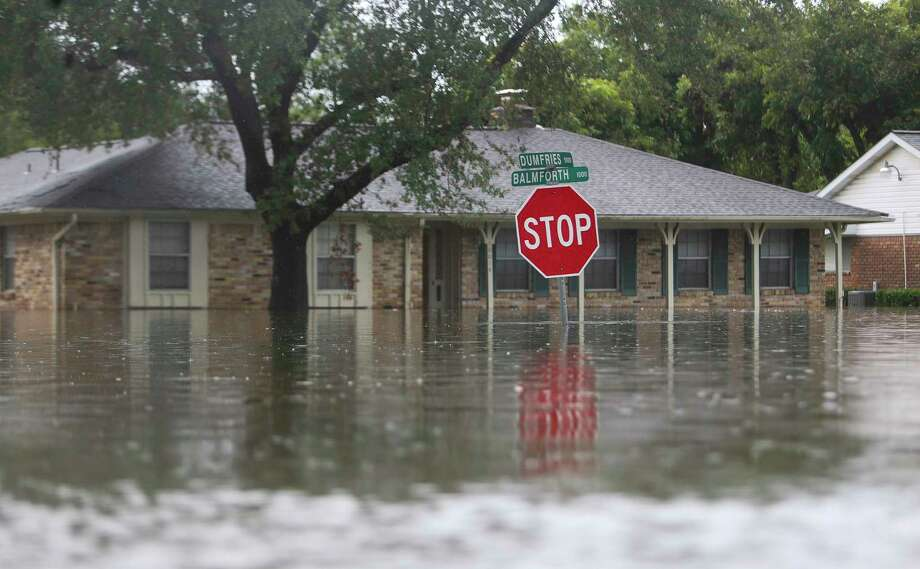 The streets of Meyerland were full of water this week. Real estate experts say Harvey will affect even properties that weren't flooded. Photo: Mark Mulligan, Staff Photographer / 2017 Mark Mulligan / Houston Chronicle