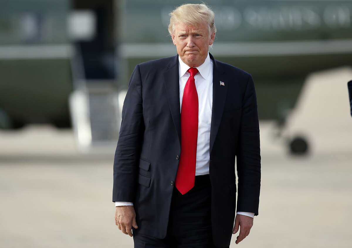 President Donald Trump pauses as he steps off Air Force One as he arrives Wednesday, Aug. 30, 2017, at Andrews Air Force Base, Md. Trump is returning from Springfield, Mo. (AP Photo/Alex Brandon)