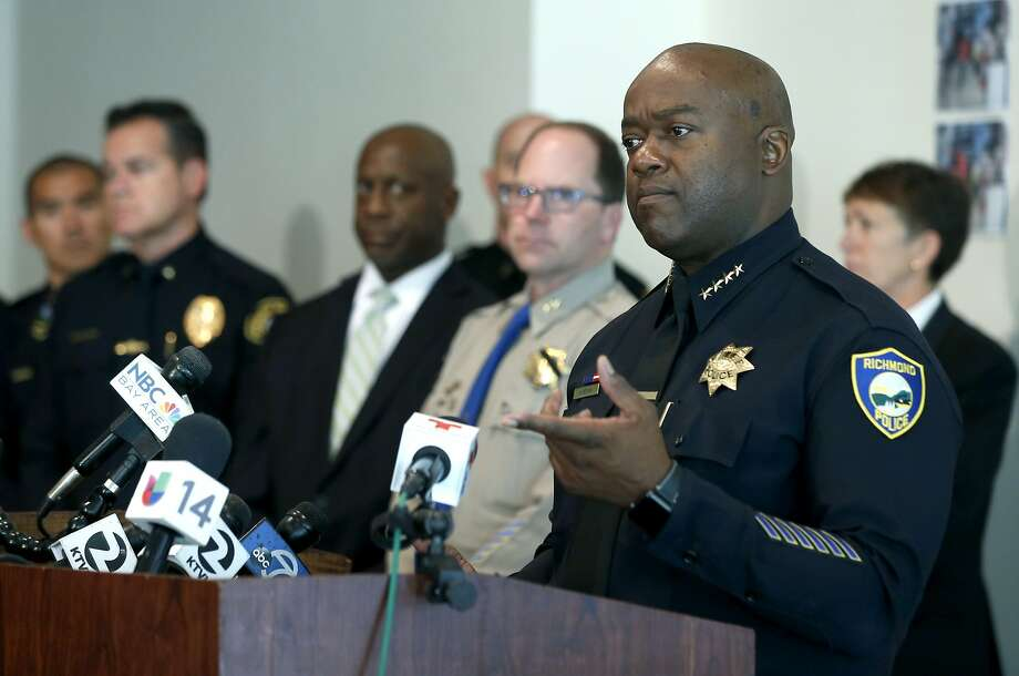 Richmond Police Chief Allwyn Brown (right) talks about the Team Swerve gang arrests. Photo: Paul Chinn, The Chronicle