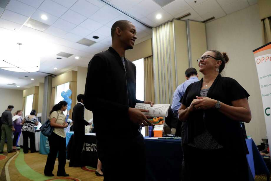 Kathy Tringali of Big 5 Sporting Goods talks to Jarrell Palmer during a job fair in San Jose, Calif.  Photo: Marcio Jose Sanchez, STF / Copyright 2017 The Associated Press. All rights reserved.