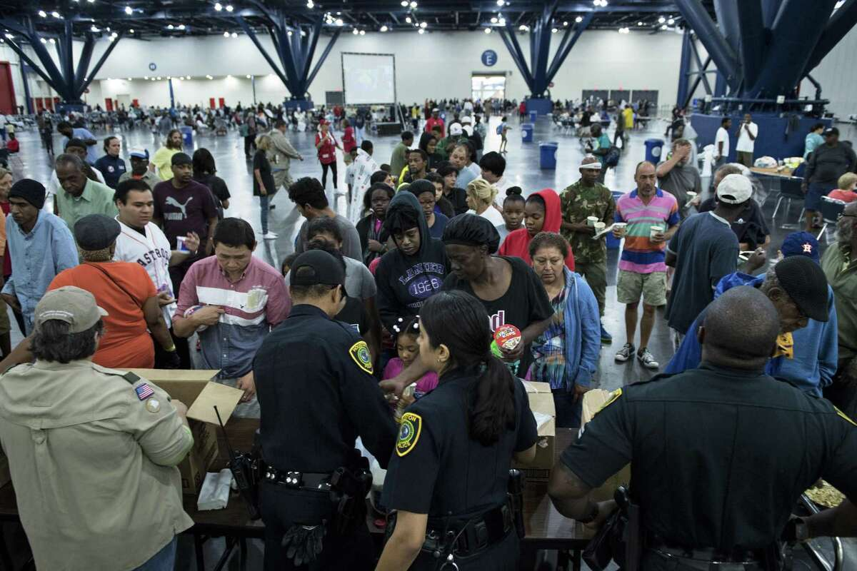 Flood victims gather for food at a shelter in the George R. Brown Convention Center during the aftermath of Hurricane Harvey on Aug. 28, 2017 in Houston.