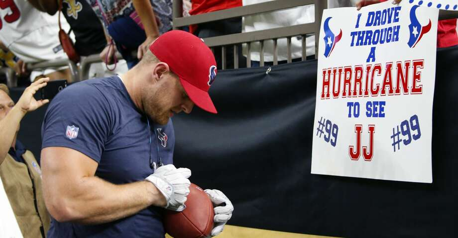 Houston Texans defensive end J.J. Watt signs autographs for fans holding sings referencing Hurricane Harvey before an NFL football game against the New Orleans Saints in New Orleans, Saturday, Aug. 26, 2017. (AP Photo/Butch Dill) Photo: Butch Dill/Associated Press