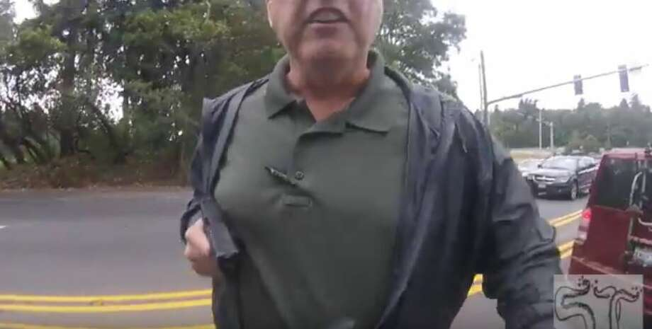 Detective Richard Rowe, a King County Sheriff's Office employee assigned to the Woodinville Police Department, was identified Wednesday as the plainclothes officer captured in footage that showed him pointing a gun at a motorcyclist during an Aug. 16 traffic stop. Photo: Squid Tips/Youtube