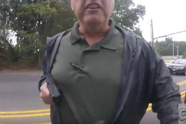 Detective Richard Rowe, a King County Sheriff's Office employee assigned to the Woodinville Police Department, was identified Wednesday as the plainclothes officer captured in footage that showed him pointing a gun at a motorcyclist during an Aug. 16 traffic stop.