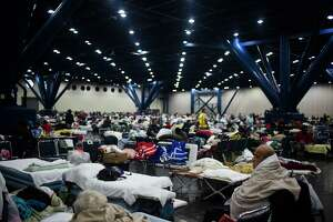 People seek shelter at the George R. Brown Convention Center in Houston.
