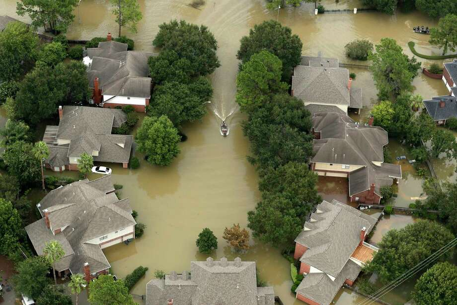 Floodwaters from the Addicks Reservoir inundate a neighborhood off N. Eldridge Parkway in the aftermath of Tropical Storm Harvey on Wednesday, Aug. 30, 2017, in Houston. Photo: Brett Coomer, Houston Chronicle / © 2017 Houston Chronicle