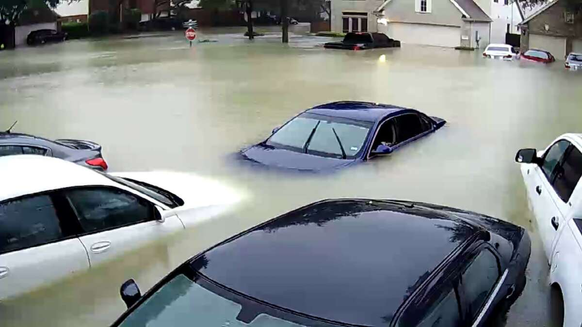 Cars underwater following Tropical Storm Harvey around theWestpark Tollway north of Richmond, Texas.