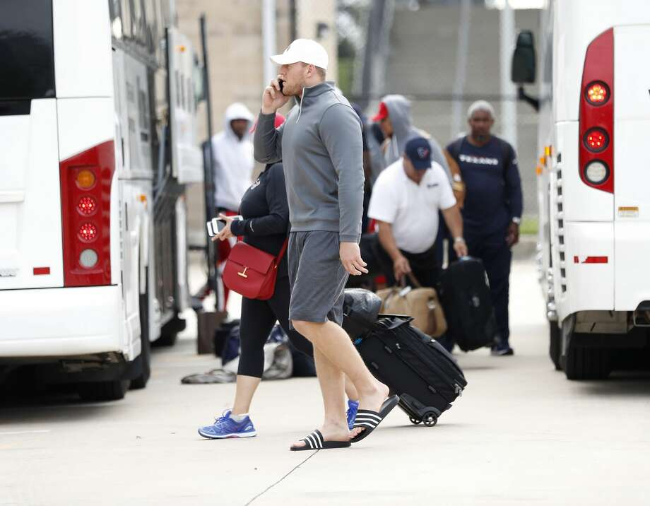 Houston Texans J.J. Watt talks on the phone after he and the team got off buses at NRG Stadium, after traveling from Dallas, Wednesday, Aug. 30, 2017, in Houston. Houston flew last week to New Orleans, then to the Dallas area, and was originally scheduled to play the Cowboys at NRG Stadium, but destruction by Hurricane Harvey and flooding from Tropical Storm Harvey. Texans were going to play the game Thursday in Dallas, but the NFL cancelled that game.  ( Karen Warren / Houston Chronicle ) Photo: Karen Warren/Houston Chronicle