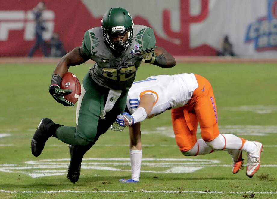 Baylor running back Terence Williams (22) escapes the grasp of Boise State safety Kekoa Nawahine (10) during the first half of the Cactus Bowl NCAA college football game, Tuesday, Dec. 27, 2016, in Phoenix. (AP Photo/Rick Scuteri) Photo: Rick Scuteri, FRE / FR157181