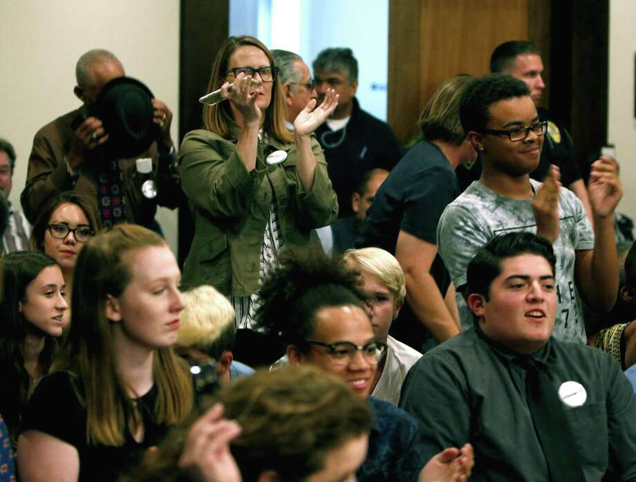 Those in attendance applaud after board voted to change the name of Robert E. Lee High School. On Tuesday evening, the North East ISD board will vote on whether to change the name of Robert E. Lee High School in the wake of the events in Charlottesville and the national debate it started about Confederate monuments. at NEISD board room on Tuesday, August 29,2017 Photo: Ron Cortes, Freelance / For The San Antonio Express-News