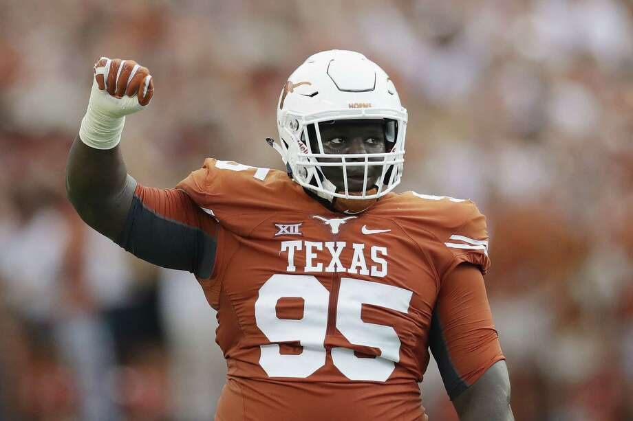 Poona Ford showed he could play well at defensive tackle despite his relative lack of height (5-11) by earning preseason All-Big 12 honors. Photo: Ronald Martinez, Staff / 2016 Getty Images