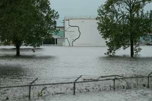 The Arkema  chemical plant is flooded from Tropical Storm Harvey Wednesday, Aug. 30, 2017, in Crosby, Texas. Floodwaters from Harvey have knocked out power and generators that keep volatile organic peroxides stored at the facility cool. Employees and about 300 homes within a mile and half radius of the plant were evacuated Tuesday.
