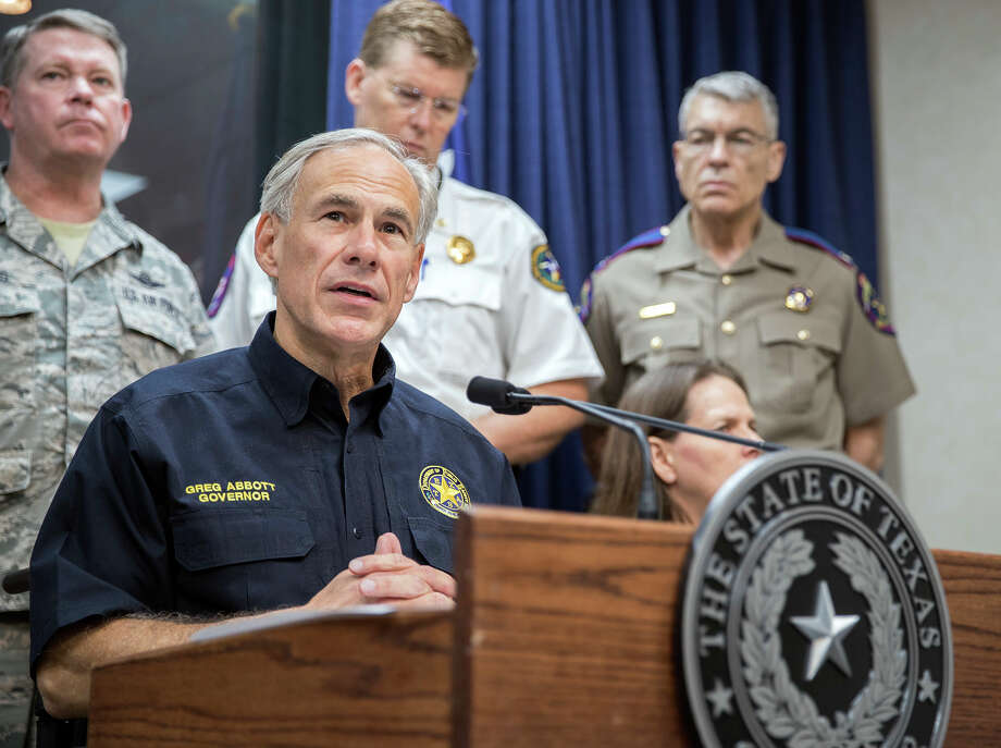Texas Governor Greg Abbott speaks during a press briefing Wednesday, Aug. 30, 2017, at the State of Texas Emergency Command Center at Department of Public Safety headquarters in Austin, Texas as he updates the public about how the Texas government plans to help the people who are affected by the Tropical Storm Harvey.  A weaker Harvey replicated its devastating roll Wednesday, returning to shore with a deluge of rain that inundated homes and highways and left police and government officials struggling to pluck people from the water.(Ricardo B. Brazziell /Austin American-Statesman via AP) Photo: Ricardo B. Brazziell, MBO / Austin American-Statesman