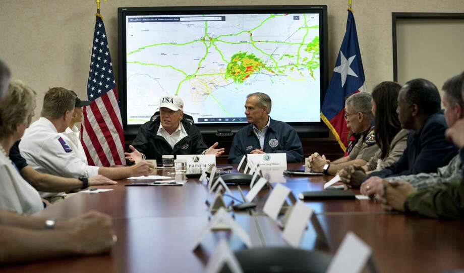President Donald Trump and Texas Gov. Greg Abbott take part in a meeting at the Texas Division of Emergency Management operations center in Austin. The emerging financial toll in the wake of Harvey is making it increasingly clear that Congress will need to pony up substantial disaster relief money when lawmakers return from a monthlong recess after Labor Day. Abbott said Trump assured him that Texas' recovery assistance needs will be met. Photo: Doug Mills /New York Times / NYTNS