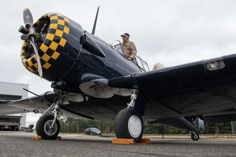 Volunteer pilot Bob Jones climbs into Historic Flight Foundation's North American AT-6 Texan for a media preview of Vintage Aircraft Weekend at Paine Field on Wednesday, Aug. 30, 2017. Photo: GRANT HINDSLEY, SEATTLEPI.COM / SEATTLEPI.COM