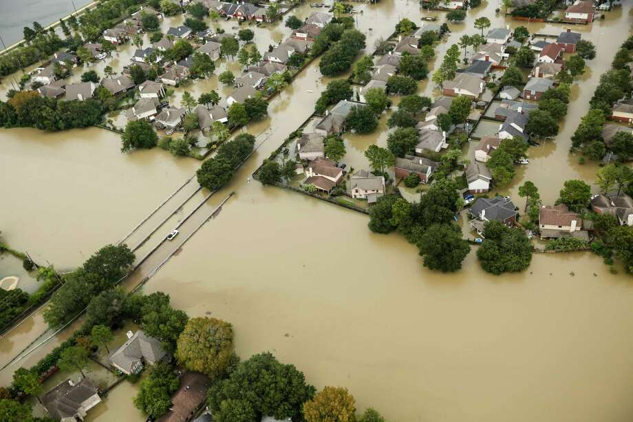 Floodwaters from the Addicks Reservoir inundate a neighborhood off N. Eldridge Parkway in the aftermath of Tropical Storm Harvey on Wednesday, Aug. 30, 2017, in Houston. ( Brett Coomer / Houston Chronicle ) Photo: Brett Coomer, Houston Chronicle / © 2017 Houston Chronicle