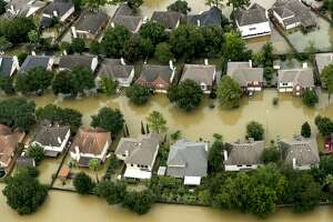 Floodwaters from the Addicks Reservoir inundate a neighborhood off N. Eldridge Parkway in the aftermath of Tropical Storm Harvey on Wednesday, Aug. 30, 2017, in Houston.