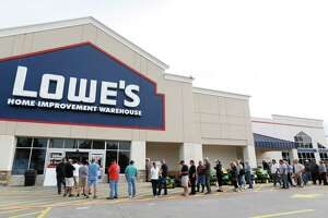 People line up to go into the Lowe's as they tried to gather supplies after rains and floods  from Tropical Storm Harvey started to subside,  Wednesday, Aug. 30, 2017, in Atascocita.  ( Karen Warren / Houston Chronicle )