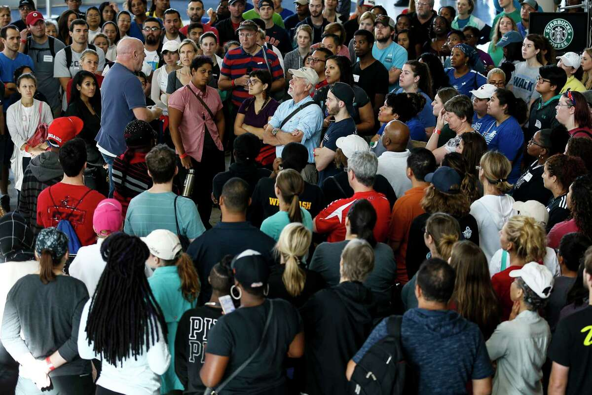 Volunteers listen to instructions at NRG Center, which opened its doors Wednesday.
