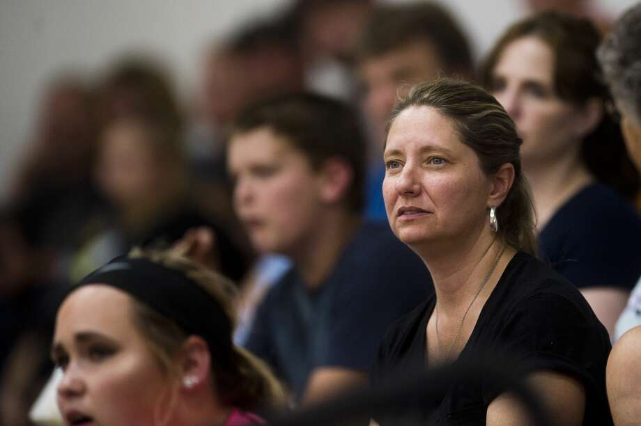 Spectators watch volleyball matches between Bullock Creek, Meridian and Pinconning High Schools on Wednesday, August 30, 2017 at Meridian Early College High School. Photo: (Katy Kildee/kkildee@mdn.net)