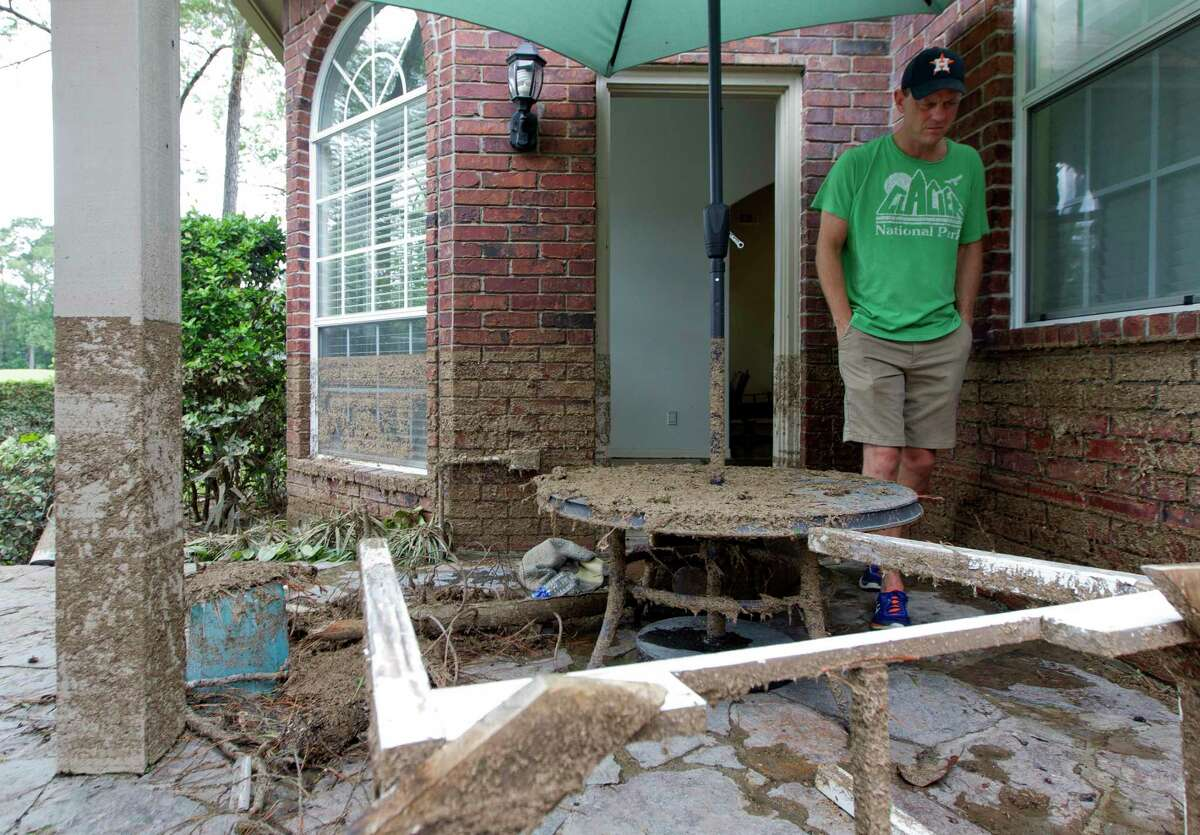 Mike Bartlow surveys the damage to his house after Tropical Storm Harvey dumped 20 inches inside his River Planation home, Wednesday, Aug. 30, 2017, in Conroe.