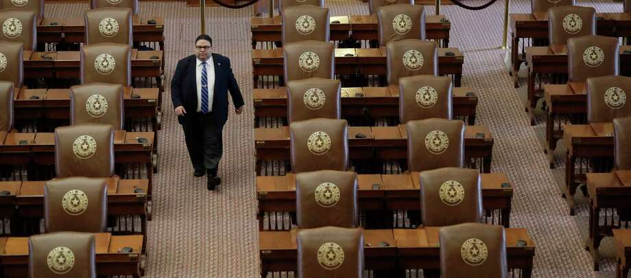 Texas House of Representatives Sergeant-at-Arms David Sauceda walks through an empty chamber on Aug. 16. (AP Photo/Eric Gay) Photo: Eric Gay, STF / Copyright 2017 The Associated Press. All rights reserved.