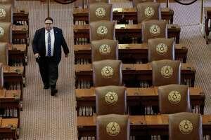 Texas House of Representatives Sergeant-at-Arms David Sauceda walks through an empty chamber on Aug. 16. (AP Photo/Eric Gay)