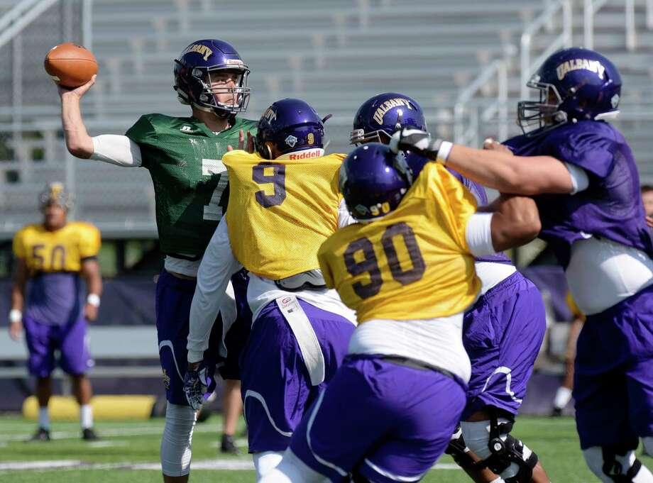 University at Albany quarterback Will Brunson runs through drills during practice on Wednesday, Aug. 30, 2017, in Albany, N.Y.        (Paul Buckowski / Times Union) Photo: PAUL BUCKOWSKI / 20041408A