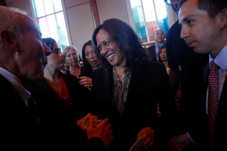 Senator Kamala Harris greets town hall attendees after the  town hall at Beebe Memorial Cathedral on Wednesday, August 30, 2017 in Oakland, Calif.