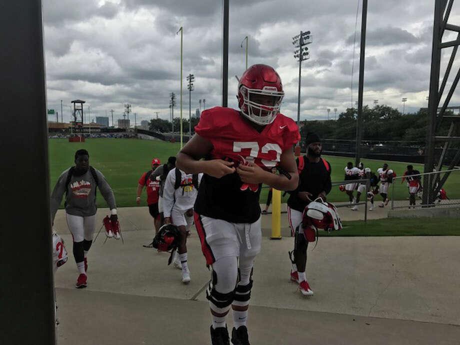 The University of Houston takes the field for practice on the University of Texas campus. The football team left Houston on Friday and hopes to return Thursday.