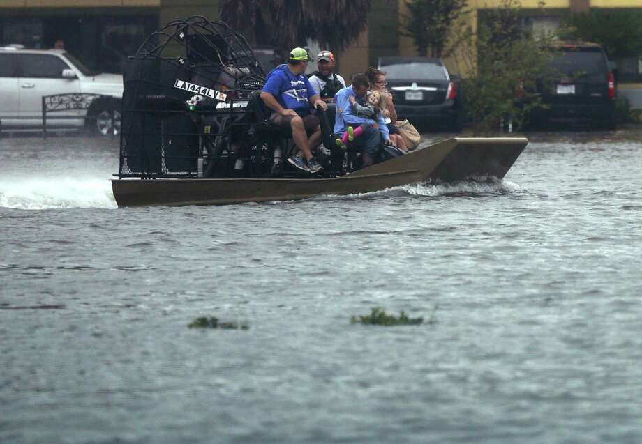 People are transported in an airboat during flooding from Tropical Storm Harvey in Orange, Texas, Wednesday, Aug. 30, 2017. (AP Photo/Gerald Herbert) Photo: Gerald Herbert, STF / Associated Press / Copyright 2017 The Associated Press. All rights reserved.
