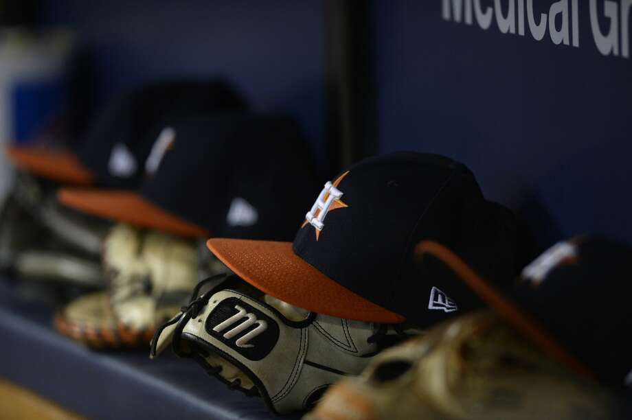 ST. PETERSBURG, FL - AUGUST 30:  Houston Astros gloves and hats are lined up in the dugout during the fifth inning against the Texas Rangers at Tropicana Field on August 30, 2017 in St. Petersburg, Florida. (Photo by Jason Behnken / Getty Images) Photo: Jason Behnken/Getty Images