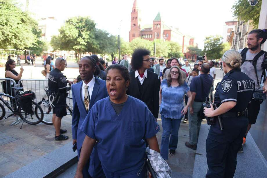 Members of the San Antonio Progressive Alliance, SATX4, Black Lives Matter and others enter City Council Chambers in Main Plaza on Wednesday, Aug. 30, 2017, as City Council hears public comments about the proposed removal of a Confederate statue located at Travis Park. Photo: Billy Calzada, Staff / San Antonio Express-News / San Antonio Express-News