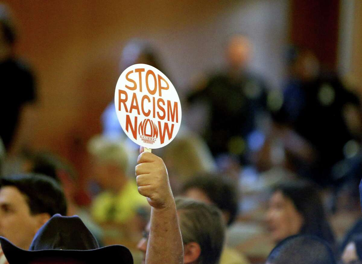 A supporter for bringing down the statue raises his sign. Municipal Complex City Council chambers People for and against the Travis Park Confederate statue will address the City Council ahead of the Thursday morning vote on removing the statue on Wednesday, August 30 ,2017