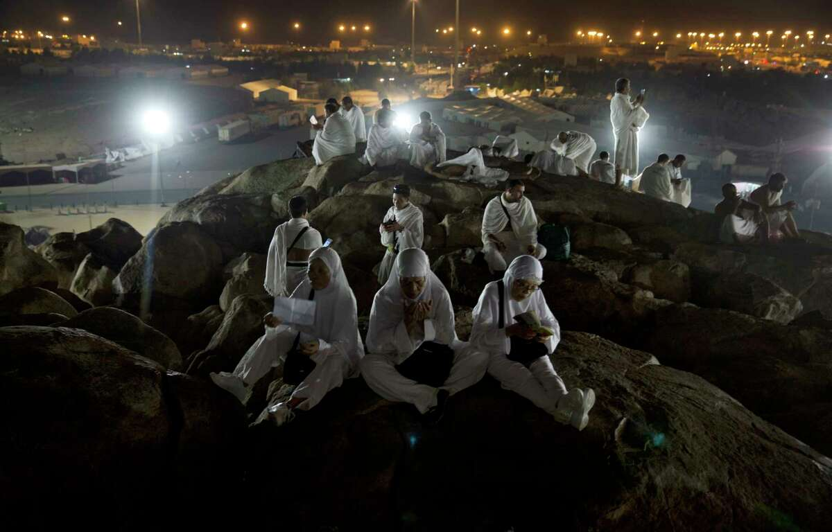 Muslim pilgrims pray on top of the Jabal Al Rahma holy mountain, or the mountain of forgiveness, upon their arrival to Arafat for the annual hajj pilgrimage, outside the holy city of Mecca, Saudi Arabia, Wednesday, Aug. 30, 2017. (AP Photo/Khalil Hamra) ORG XMIT: KH101