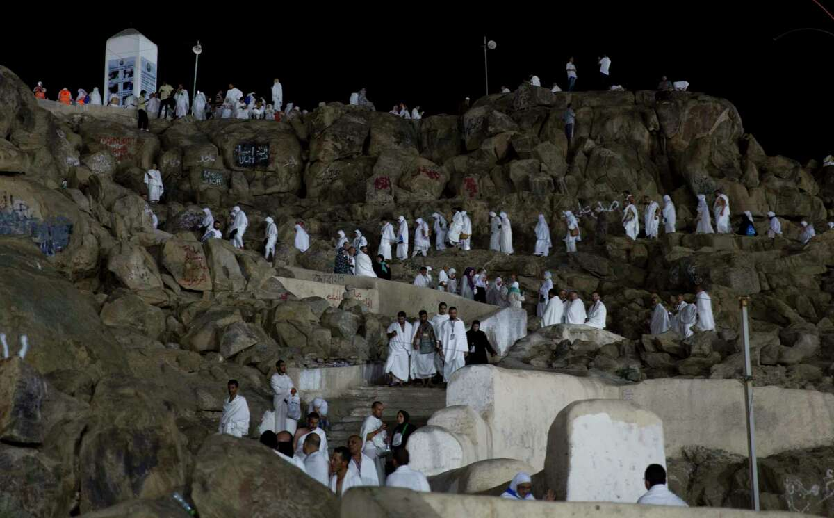 Muslim pilgrims visit the Jabal Al Rahma holy mountain, or the mountain of forgiveness, upon their arrival to Arafat for the annual hajj pilgrimage, outside the holy city of Mecca, Saudi Arabia, Wednesday, Aug. 30, 2017. (AP Photo/Khalil Hamra) ORG XMIT: KH106