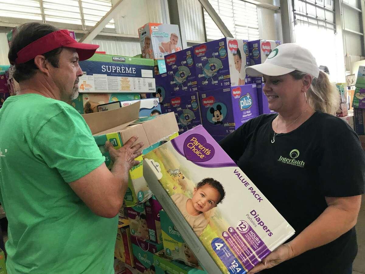 Volunteers help with supplies.