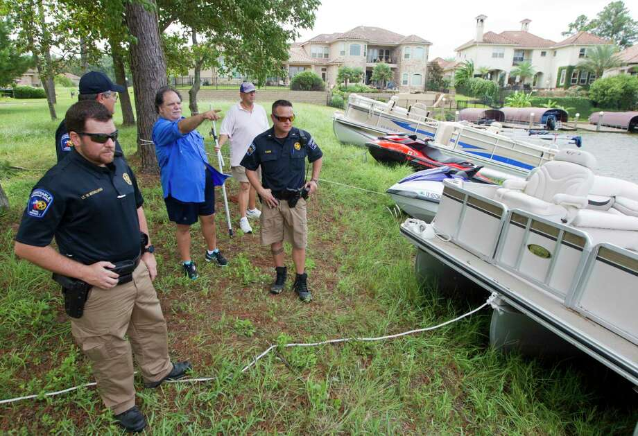 Dan Orsini points out areas to deputies from Montgomery County Constable's Office where unsecured boats might have drifted.  to on Lake Conroe, Wednesday, Aug. 30, 2017, in Conroe. Photo: Jason Fochtman, Staff Photographer / © 2017 Houston Chronicle