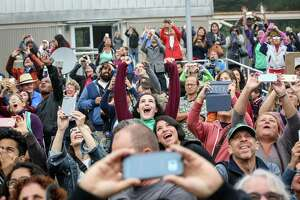 The crowd at the Chabot Space & Science Center reacts to the solar eclipse as the sun finally breaks through the fog and clouds in Oakland on Monday, August 21, 2017.