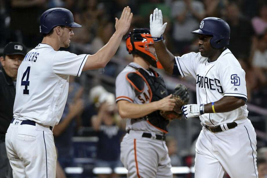 San Diego Padres' Jose Pirela, right, is congratulated at home plate by Wil Myers after hitting a home run during the sixth inning of a baseball game against the San Francisco Giants. Photo: Orlando Ramirez, Associated Press