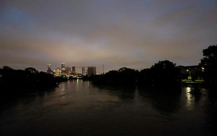 The sun sets over Houston at the footbridge on Studemont hours after the final rains from Tropical Storm Harvey subsided earlier in the day  Tuesday, Aug. 29, 2017, in Houston.  ( Karen Warren / Houston Chronicle ) Photo: Karen Warren, Staff Photographer / @ 2017 Houston Chronicle