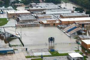 Four of the eight schools in Sheldon ISD - including C.E. King High School, shown here - were heavily damaged. The district will start school Sept. 18.