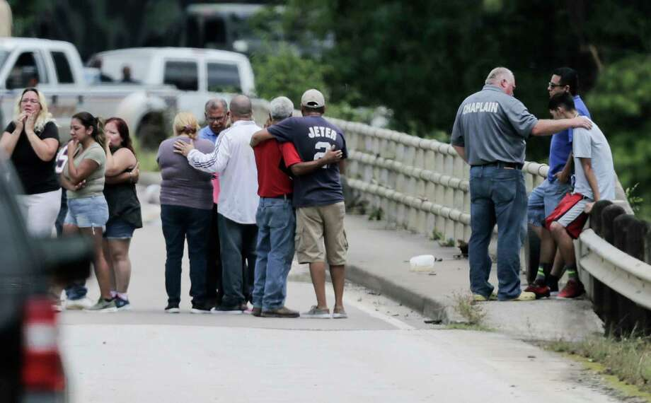 Relatives console one another as a van is pulled out of Greens Bayou with the bodies of six family members Wednesday. Photo: Elizabeth Conley, Staff / © 2017 Houston Chronicle