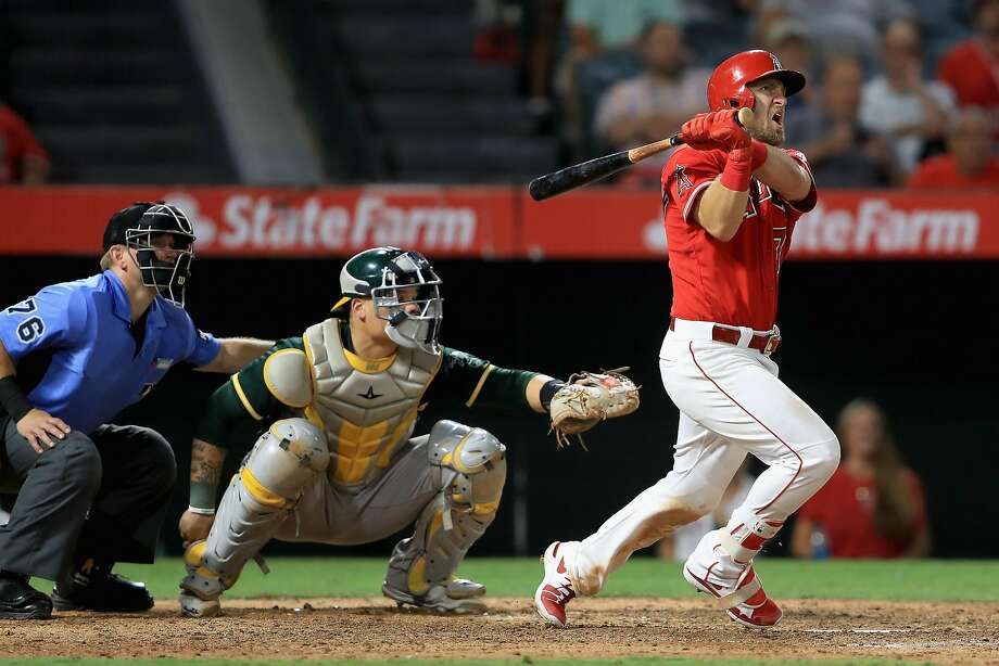 ANAHEIM, CA - AUGUST 30:  Cliff Pennington #7 of the Los Angeles Angels hits a grand slam homerun as Bruce Maxwell #13 of the Oakland Athletics looks on during the seventh inning of a game at Angel Stadium of Anaheim on August 30, 2017 in Anaheim, California.  (Photo by Sean M. Haffey/Getty Images) Photo: Sean M. Haffey, Getty Images