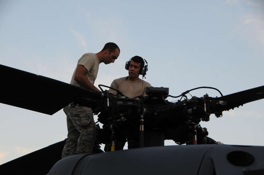 Air Force Tech. Sgt. Michael Austin and Air Force Airman 1st Class Giovanni Risco, both crew chiefs with the 106th Rescue Wing assigned to the New York National Guard, work on the rotor of an HH-60 Pavehawk helicopter at Fort Hood, Texas, on Aug. 28, 2017. The Pavehawk had landed from its day's mission over Houston that helped save 255 people and 2 dogs. (U.S. National Guard photo by Airman 1st Class Daniel H. Farrell) Photo: (U.S. Air National Guard Photo By Daniel H. Farrell