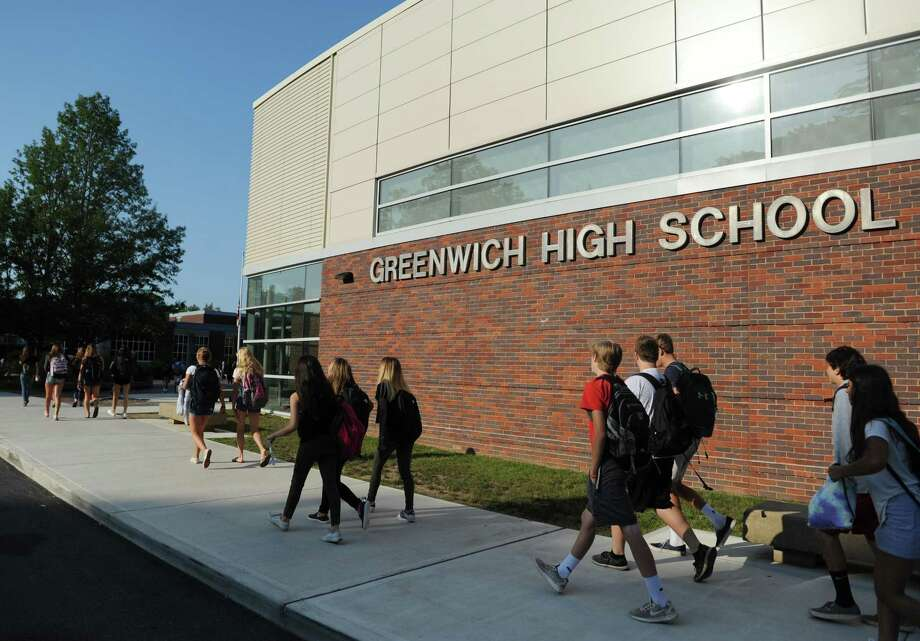 Students walk into school on the first day of the 2017-2018 school year at Greenwich High School in Greenwich, Conn. Thursday, Aug. 31, 2017. Photo: Tyler Sizemore / Hearst Connecticut Media / Greenwich Time