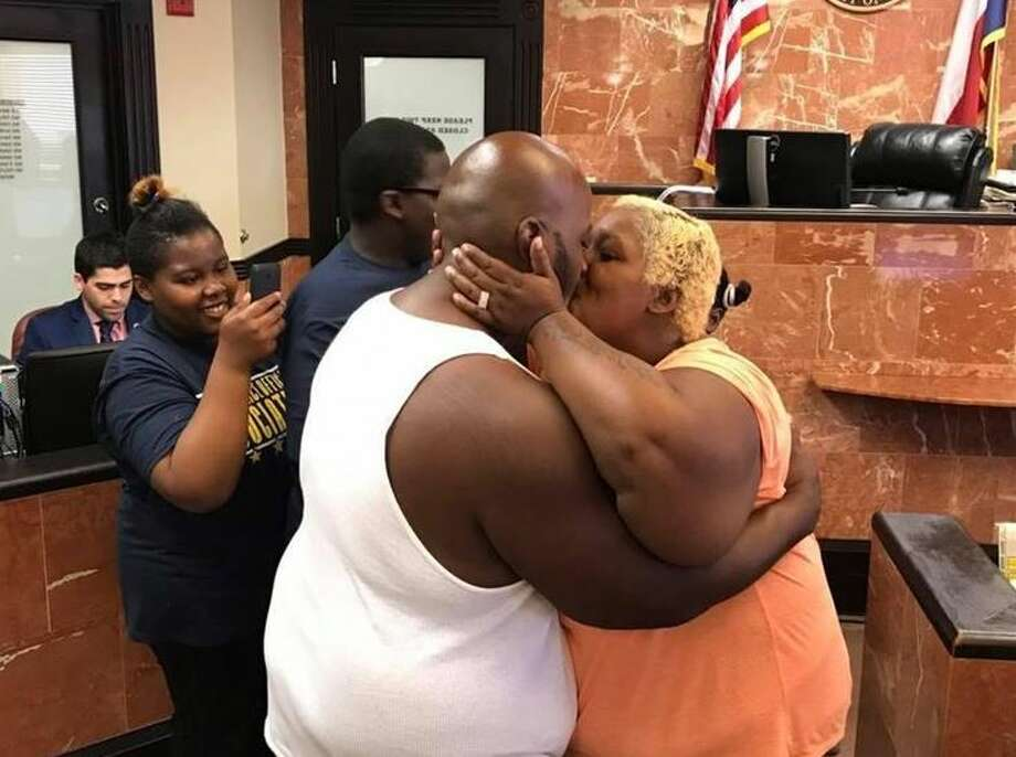 Newlyweds kiss in the 406th District Court on Tuesday after Judge Oscar Hale presided over their wedding ceremony. The couple are from Corpus Christi but had to evacuate due to Hurricane Harvey. Photo: Courtesy