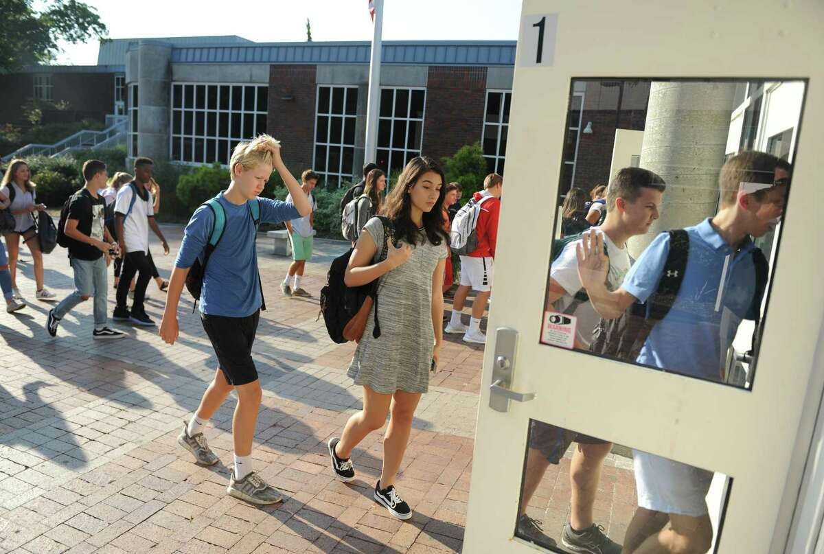 Students walk into school on the first day of the 2017-2018 school year at Greenwich High School in Greenwich, Conn. Thursday, Aug. 31, 2017. The high school's start time this year is 8:30 a.m., one hour later than previous years. In addition, the three middle schools begin at 8 a.m., 15 minutes later than in the past, while all 11 elementary schools begin at the same time.